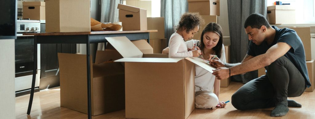 Family and packing boxes